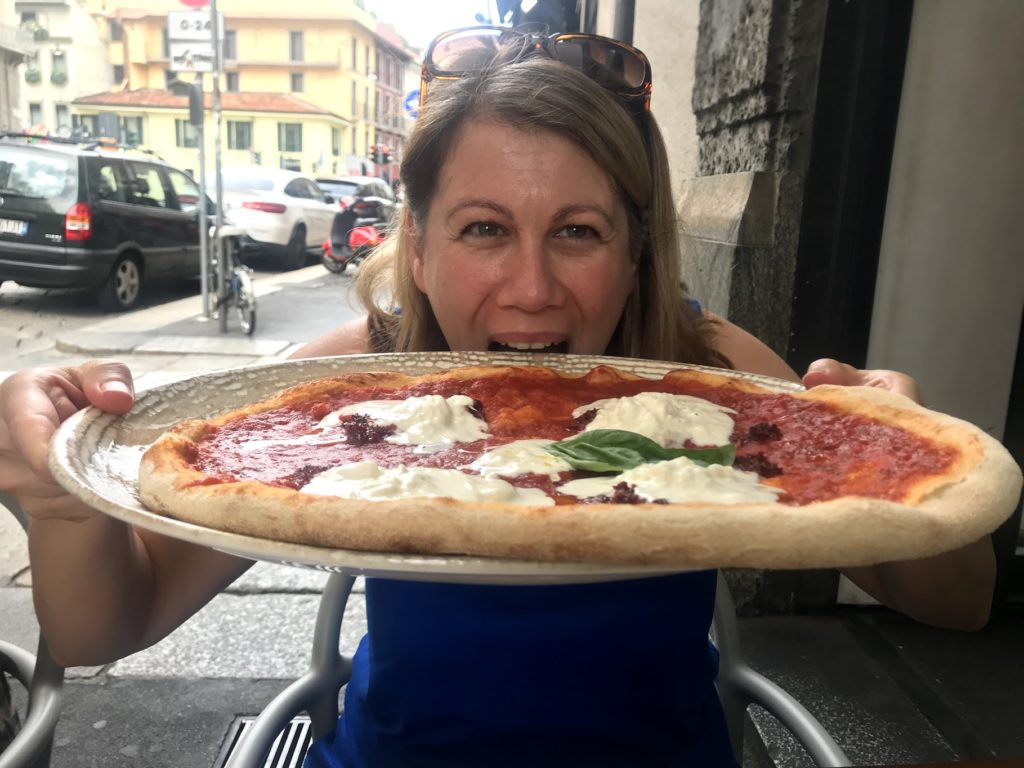 eating a large pizza in italy